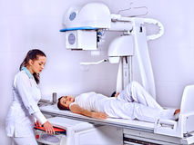 Patient  in x-ray room looking at doctor Stock Photos
