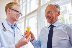 Patient receives drug from doctor. Senior patient receives drug from doctor for therapy treatment royalty free stock photography