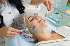 The patient receives procedure Darsonvald. His face is smeared with gel. Royalty Free Stock Images