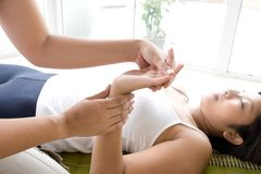 Patient receiving hand massage. Stock Photography