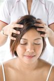 Patient receiving head massage Royalty Free Stock Image