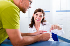 Patient at reception of doctors office Stock Image