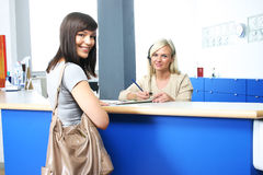Patient & receptionist Royalty Free Stock Photo