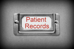 Patient Records Drawer File. A black and white image of a metal drawer label holder with a white card and the title Patient Records added in red text Royalty Free Stock Image