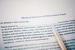 Patient release of information form with HIPAA regulations documents. Medical release of information form.  Royalty Free Stock Images