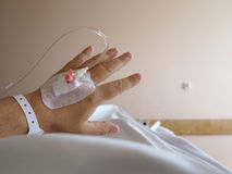 Patient's hand in the hospital with an IV Royalty Free Stock Images