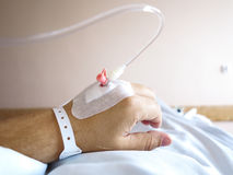 Patient's hand in the hospital with an IV Stock Images