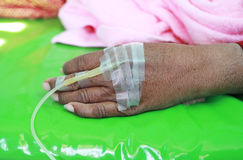Patient's hand with an intravenous drip. Patient's hand with an intravenous Stock Photo