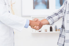 Patient shaking hands with doctor Stock Photography