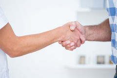 Patient shaking hands with doctor Stock Images