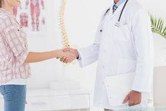 Patient shaking hands with doctor Stock Photo