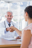 Patient shaking hands to doctor Royalty Free Stock Image