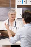 Patient sitting at doctor's office Stock Images