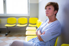 Patient sitting in a waiting room Royalty Free Stock Photography