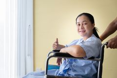 Patient sitting in a wheelchair with good encouragement royalty free stock photo