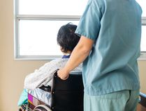 Patient Sitting On Wheelchair While Nurse Royalty Free Stock Photography
