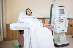 Patient Sleeping While Listening Music at Dialysis Royalty Free Stock Photos
