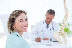 Patient smiling at camera. In medical office Stock Photos