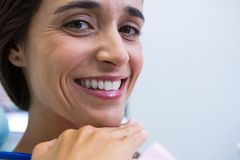 Patient smiling at medical clinic. Close up of patient smiling at medical clinic Royalty Free Stock Images