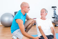 Patient speaking with his trainer Stock Images