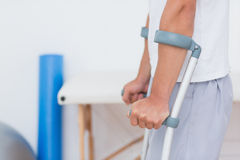 Patient standing with crutch Royalty Free Stock Photo