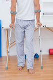 Patient standing with crutch Royalty Free Stock Image