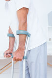 Patient standing with crutch Royalty Free Stock Photography