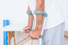 Patient standing with crutch Stock Image