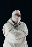 Patient in straitjacket and chains Royalty Free Stock Photo