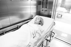 Patient before surgery in elevator Royalty Free Stock Photo