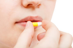 Patient takes pill close up Stock Photography