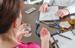 Patient taking her medicine Royalty Free Stock Photo