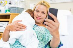 Patient Taking Self Portrait With Babygirl Through Stock Photos