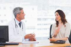 Patient talking with her doctor about illness Royalty Free Stock Image
