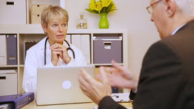 Patient talking to doctor in office stock video footage