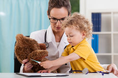 A patient and a teddy bear Stock Images