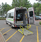 Patient transport taxi. Photo of patient transport taxi showing ramp in lowered position ready to take passengers Stock Photos