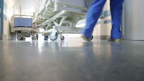 Patient Transportation in Hospital. On Surgical Bed stock video footage