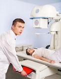 Patient with trauma and doctor in x-ray room. Stock Images