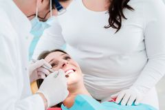 Patient treated by dentist in his surgery Royalty Free Stock Image