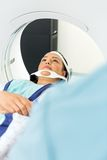 Patient Undergoing CT Scan In Examination Room Royalty Free Stock Images