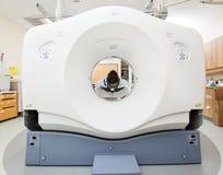 Patient Undergoing CT Scan Test. Female patient undergoing CT scan test in examination room Stock Photo