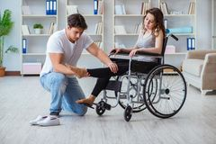 The patient undergoing rehabilitation recovery programme with doctor. Patient undergoing rehabilitation recovery programme with doctor stock image