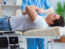 Patient undergoing rehabilitation recovery programme with doctor stock photography