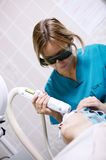 Patient undergoing skin treatment with a laser Royalty Free Stock Photography