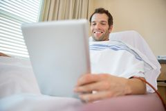 Patient Using Digital Tablet During Renal Dialysis Stock Images