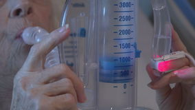 Patient using an incentive spirometer or volume exerciser stock video
