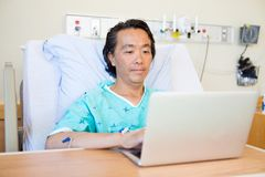 Patient Using Laptop On Hospital Bed Stock Photography