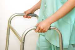 Patient using a walker,walking aid for training Stock Photo