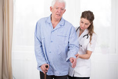 Patient using walking stick Royalty Free Stock Images